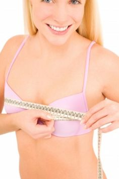 What causes breast tenderness and swelling