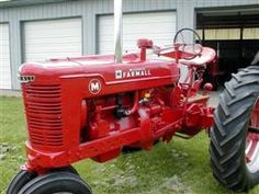 1948 Farmall M ...very similar to the one my Grandfather had on his farm that he would let me drive when I was just a kid. That farm was like Disneyland to a city boy like me!