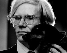Andy Warhol and Archie, his dachshund.