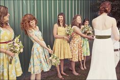 Mismatched floral bridesmaids.  Maybe it'd be nice to have it be somewhat matchy, like say floral prints in mostly blues?  That'd be pretty right?  @Greg Sudds D★