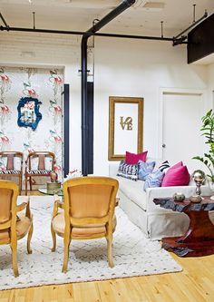 My living room.  Wallpaper. Moroccan style rug, gold french chairs, rustic wood table, slipcover sofa.  Design Manifest