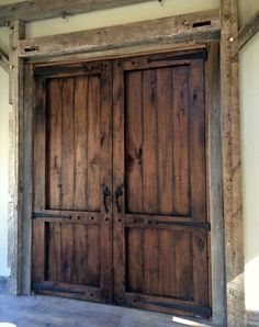 Reclaimed walnut was used to make these gorgeous barn doors. Using reclaimed tim… Reclaimed walnut was used to make these gorgeous barn doors. Using reclaimed timberframe for trim and salvaged iron hardware, it really gives it an authentic look. Barn Door In House, Barn Door Closet, Diy Barn Door, Barn Door Garage, Timber Garage, Interior Sliding Barn Doors, Sliding Barn Door Hardware, Sliding Doors, Door Hinges