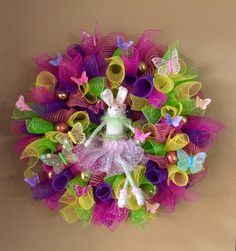 I really loved this Easter wreath! So colorful and full of butterflies and finished off with a ballerina Easter bunny!