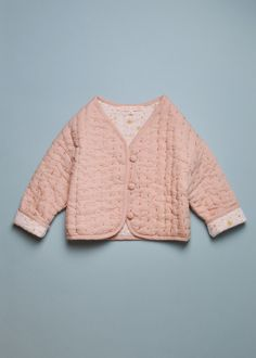 I think it would be so pretty to hand quilt the Lullaby Layette jacket with purl cotton, sort of like this.