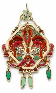 Art Nouveau enamel and silver pendant designed as a lily flower set with in a lozenge shaped frame, decorated with enamel, mounted in gilded silver. By Suau de la Croix, ca.1890.