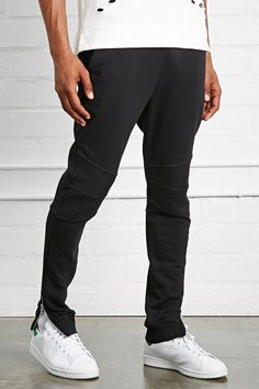 A pair of knit moto joggers with an elasticized drawstring waist, slanted front…