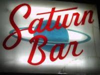 "Art in New Orleans - the Saturn Bar - 9th Ward institution has become a haunt for out-of-town visitors & members of cafe society, in addition to the regular crowd of neighborhood working peopl... ""funky decor, friendly bartenders  if you're lucky, some cool live music.""   Cheap drinks, awesome bands  packed house.Diviest of the dive bars, in a good way!! Bad art, cheap drinks, crazy locals who wanna buy you a beer (yes, please), tattered seats, creepy bathroom facilities and FABULOUS swag."