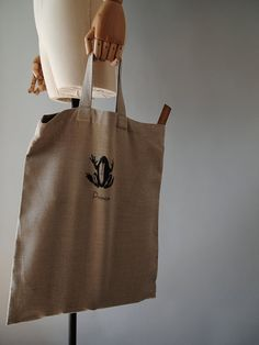 Frog Prince Tote by knife in the water.