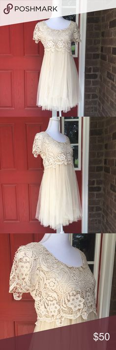"Mod Cloth Cream Lace and Netting Dress This dress is absolutely gorgeous! The full skirt is made from layers upon layers of netting with a delicate cream slip underneath. The empire waist top is covered in a sturdy Floral Lace. In good condition. Made from cotton and polyester. Approximate measurements lying flat: Bust 18"", Waist 13"" (unstretched), Length 34"", 36 final layer of tulle 30255 Ryu Dresses"