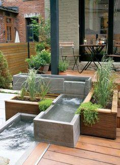 moderne Terrassengestaltung - Holzboden - Teiche aus Beton