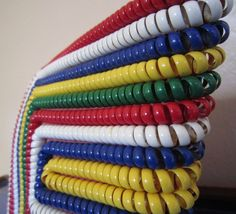 I love these old telephone cord handbags