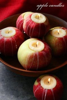 (1) Cut, core, and slice open apple  (2) Insert candle  (3) Glue apple slices back around candle  (4) Arrange apple/candles  (Oh...why do you need candle holders?)