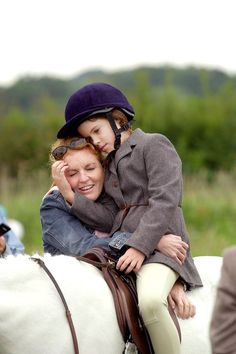 Sarah, Duchess of York, with Princess Eugenie of York at a horse show in the south of England. 2000