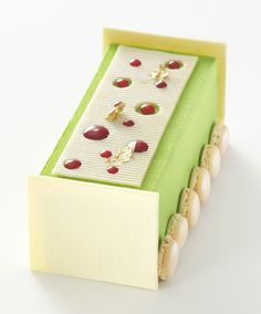 Arnaud Larher Bûche Apple Pomme Pastry chef Arnaud Larher's Bûche Apple Pomme applies the flavors of apple and strawberry to the red-and-green color scheme of Christmas. Here, green apple ganache, strawberry compote, and green apple cream are layered with almond sponge cake.  53 rue de Caulaincourt 75018, arnaud-larher.com, 01.42.57.68.08; 43.00€
