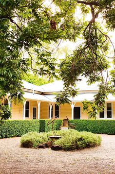 Built in the by Hugh's grandfather, the farmhouse is an architectural amalgam of Federation and Art Nouveau styles. Manicured olive hedges frame the verandah wrapped around the home. Farmhouse Garden, Farmhouse Plans, Farmhouse Style, Farmhouse Decor, French Farmhouse, Victorian Farmhouse, French Country, Modern Farmhouse, Australian Country Houses
