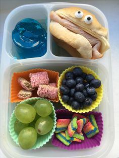 A silly little lunch for tomorrow.  I ran out of bread so had to improvise!!  This is blueberry Jell-O, turkey and American cheese sandwich (with eyes!!!), blueberries, Air Head Xtreme bites, grapes, strawberry mini-wheats  :)