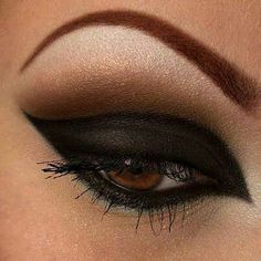 Perfect Black smokey eye for cat makeup Halloween think penciled-in brows with stark contrast highlight and beautiful cat-eye
