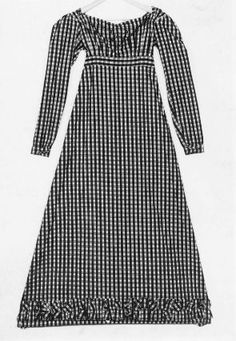 Day dress. French, early 19th century. Yellow, red, green cotton plaid. Horizontally pleated neckline with drawstring closure at back; 8 front darts into waistband, gathered at back waistline; false lacing of green cording around blue silk thread covered buttons at front. Long sleeves, short welted slit cuffs with hook-and-eye closures. Band of ruching at skirt hem - in the Museum of Fine Arts Boston