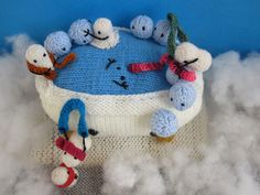 Tiny snowmen warm up with a piping hot bath in this cute scene by knitter Joan! Patterns from Mochimochi Land.