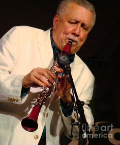 Paquito D'Rivera intensely playing his clarinet at a jazz concert. Click image to buy prints.