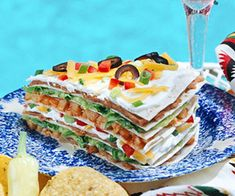 "The layered look is ""in"" for summer dining, especially with this quick-to-assemble Mexican entree. It's perfect for any summer party!"