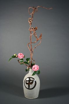 Camellias and Kiwi Branches ikebana Japanese flower arrangement