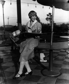 The uniform of this 1920s waitress shows a bit of flapper influence