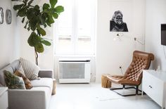 air bnb living room Budapest | the lovely drawer | cute, minimal apartment with clever use of space creating a clean and fresh home
