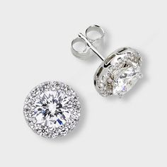 Designer cubic zirconia stud earrings featuring 1.0 carat each (6.5mm) brilliant round surrounded by prong-set small round stones. An approximate 2.70 total carat weight. These popular cubic zirconia earrings are available in 14k white gold or 14k yellow gold. Cubic zirconia weights refer to equivalent diamond carat size.