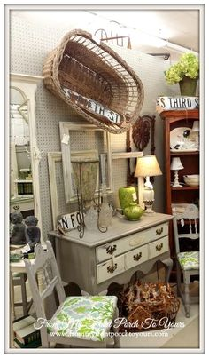 Two drawer table is like one I have. Taupe with creme white drawers. Antique Booth Displays, Vintage Store Displays, Antique Mall Booth, Market Displays, Vintage Display, Antique Shops, Retail Displays, Merchandising Displays, Window Displays