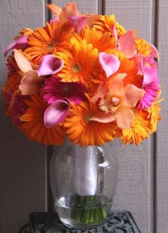 Orange Daisies and Orchids - idea for birthday bouquet