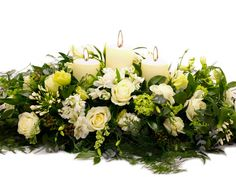 Marriage candle arrangement in soft whites and lush green tones