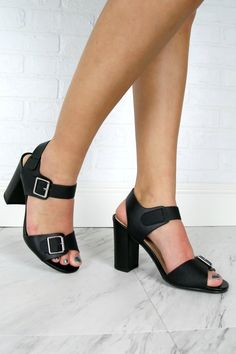 This shoe features a snake leatherette upper, front band and ankle strap accentuated by silver hardware oversized buckle. The mid height block heel make Facebook Black, Sale Items, Block Heels, Ankle Strap, Heeled Mules, Peep Toe, Transgender, Final Sale, How To Wear