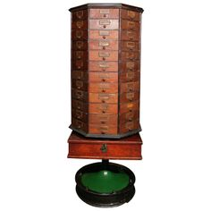 General Store Cabinet on Revolving Stand Early 20th Century. | From a unique collection of antique and modern cabinets at http://www.1stdibs.com/furniture/storage-case-pieces/cabinets/