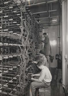 Elstree telephone exchange wiring fitting, 1935; terminating line cables in M.D.F.. IET Archives NAEST 211/02/08/01 C.1972