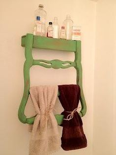 The back of an old chair turned upside down and used as a bathroom shelf and towel rack. Whoa.