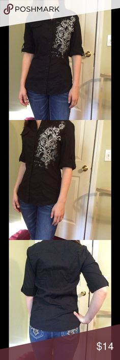 Women's button up shirt Decorative women's button up shirt with roll up sleeves that button in place. Tags say large fits more like a small. Bust is 34 length is 26 inches. Dolled Up Tops Button Down Shirts