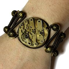 Steampunk bracelet with antique watch movement by Catherinette Rings : http://www.etsy.com/shop/CatherinetteRings
