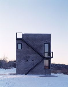 Cube House by Simon Ungers. CHARCOAL CONCRETE BLOCKWORK. EXPOSED BLACK STEEL STAIRCASE. MINIMAL FORM