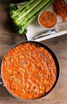 Lentil Bolognese Lentil Bolognese 2 T. olive oil 1 onion, finely diced 3 large carrots, peeled and chopped 7 cloves garlic, minced 1 (6 oz.) can tomato paste 1 (15 oz.) can tomato sauce 2 (14.5 oz.) cans diced Italian tomatoes 2 T. dried sweet basil 1 tsp. dried oregano 1/4 tsp. baking soda Salt and pepper to taste 2 c. red lentils, rinsed and picked over 2 c. water