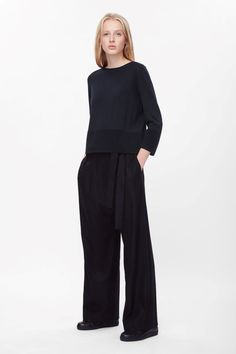 This jumper is made from finely knitted merino wool with wide tightly ribbed edges. An A-line shape that is slightly cropped, it has 3/4 sleeves and a simple round neckline.