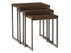 Conal nesting tables were made for casual entertaining. This resourceful trio of tables comes in a sleek contemporary design, with dark brown wood tops and metal sleigh bases.