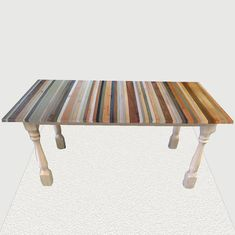 Beach Stripe Wood Dining Table: hand made reclaimed wood table in a brown, tan, white, blue, and green color palette inspired by the beach. Custom furniture.