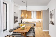 The kitchen features white-oak millwork cabinetry, Pietra Lavica stone countertops, and Waterworks fixtures.