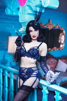Burlesque performer Dita Von Teese strips down for a sexy lingerie shoot captured for online fashion app WhoYouAre. The 43-year-old star wears a limited-edition collection of couture hats and pins by Victoria Grant and Stephen Webster, according to WWD. Captured on location at California's Madonna Inn, Von Teese poses in her signature retro styling while …