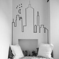 Washi Tape NYC Wall Decor. I really like this idea for small walls. See more at Interiors TEA BFOR. Great headboard alternative!