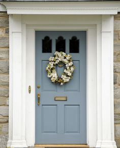 Exterior. grey wooden door with round white wreath and golden handle. Chic Front Door Colors For Brick Houses Offers Amazing Nuance