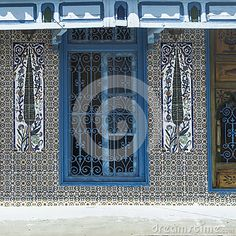 Traditional white and blue building in Tunis. Street in Tunis, Tunisia. Africa.