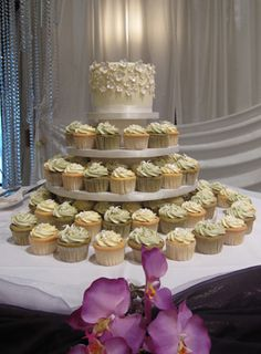 Cake Topper? Wedding cupcake tower with cake topper, via Flickr.