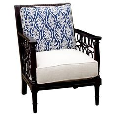 Highlighting open latticework sides with a rich dark finish, this British Colonial-style arm chair is refreshed with a crisp white seat and blue coral-motife...